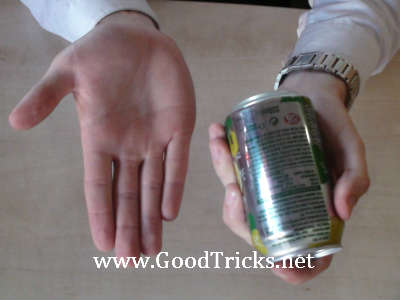 Magician's hand is shown to be empty.