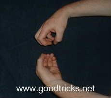 Drop coin into palm of lower hand and remove other hand , at the same time closing the fingers on the upper hand.