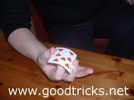First finger should be flicked , causing top card to jump into the air.