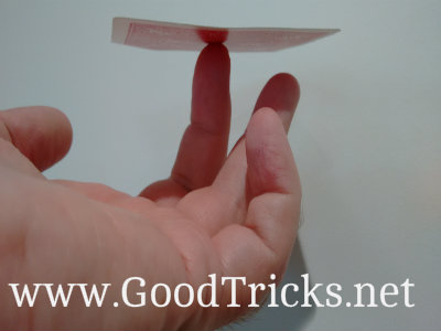 With the center of the card resting on your finger. The card should remain balanced horizontally.