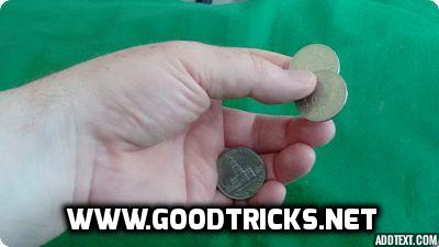 Image showing one of the coins hidden in a finger palm position.