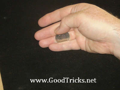 Thumb is brought across to slide coin over to the thumb side of your palm.