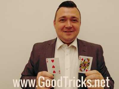 Magician amazingly reveals the two secretly chosen cards.
