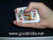 Grip the edge of the pack with your fingers and use your thumb to peel off the top card.