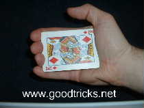 Hold cards in the palm of the hand in palm position