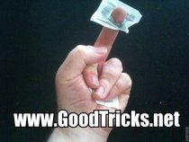 Place this sugar packet on your middle finger.