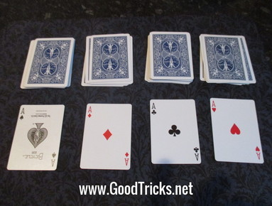 Four aces shown that were on top of each pile of cards in this fantastic magic trick.