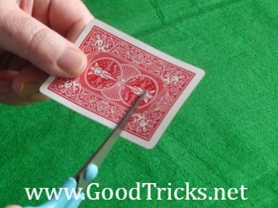 Image showing preparation of playing card for card illusion trick.