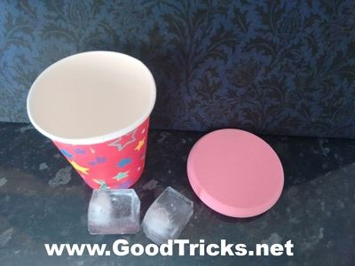 To perfom this magic trick you need a paper cup, some ice, a glass of water and a small piece of sponge.