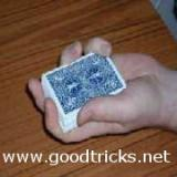 Hold deck in your left hand, with the tips of your fingers resting on top right edge and the base of thumb resting on bottom left edge of deck.