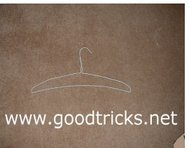 Squeeze the coat hanger to form a rod shape.
