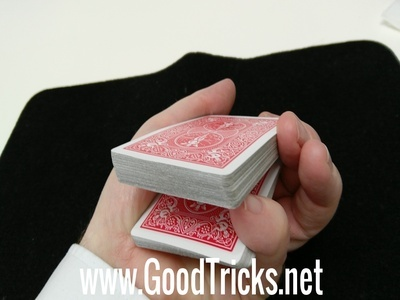 Obtain pinky break so that spectator's card will rest on yop of your pinky.